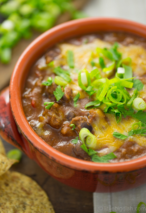 Burger chili is all about additional flavors that beautifully browned meat and caramelized onions and other vegetables bring, making it deliciously gourmet.