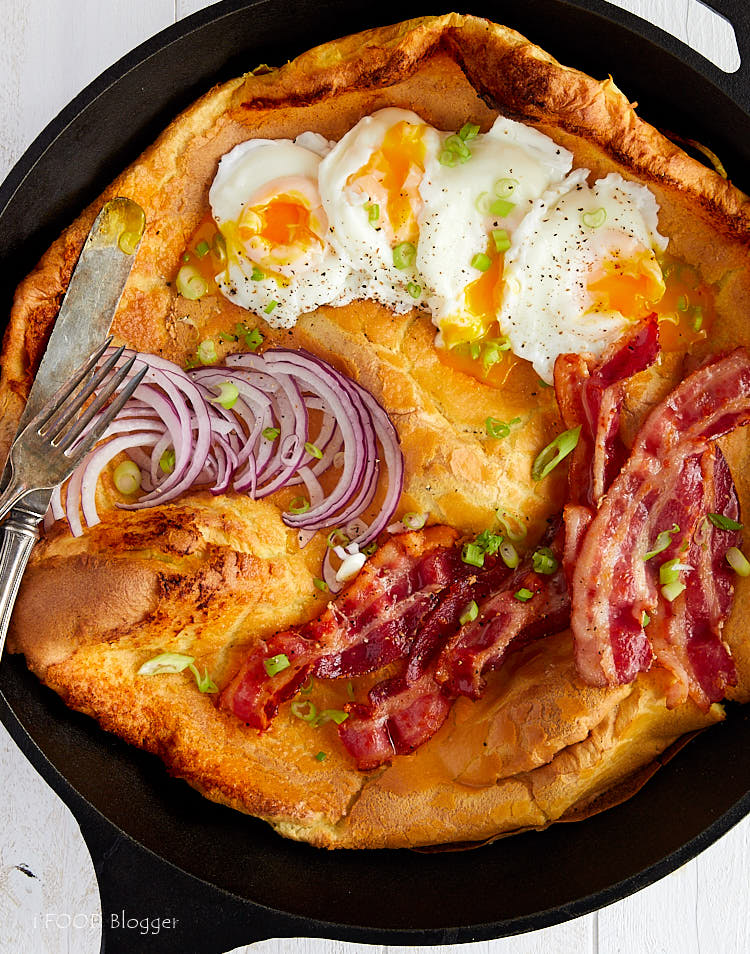 Savory Dutch Baby served with poached eggs, fried bacon and onions | ifoodblogger.com