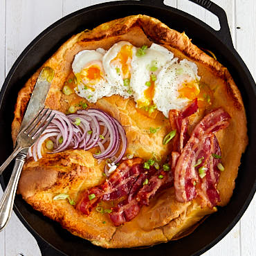 Savory Dutch Baby with Bacon and Poached Eggs