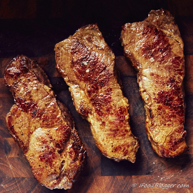 Perfect steak cooked indoors on the stove? Absolutely! The best way to cook a steak indoors is to start with pan searing and finish in the oven. The steak will be perfectly caramelized a=on the outside and tender inside.Easy to follow instructions.