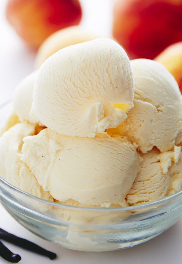 All natural and scratch-made homemade peach ice cream. Juicy, ripe peaches and vanilla beans create unforgettable flavors, making you crave more of this delicious, perfect for summertime frozen treat.