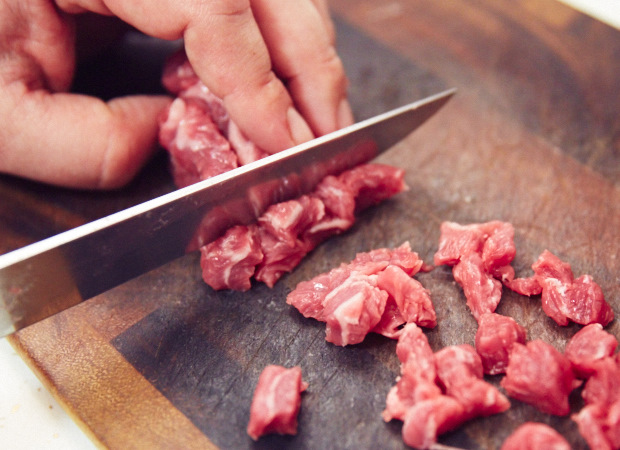 Chopping meat for sambusa