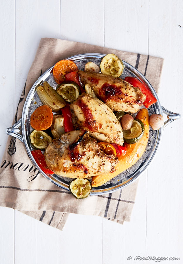 Roasted Bone In Chicken Breast with sweet potatoes, clementines and other vegetables