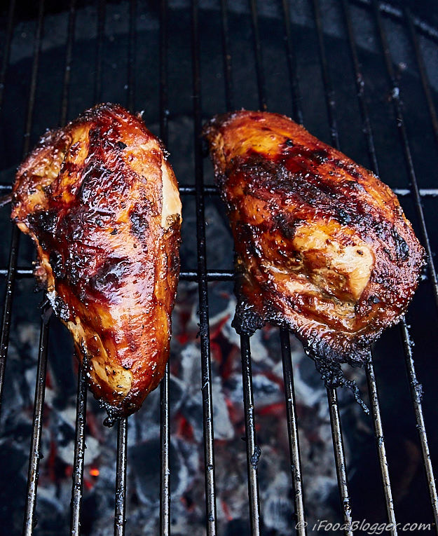 Chicken breasts on a grill.