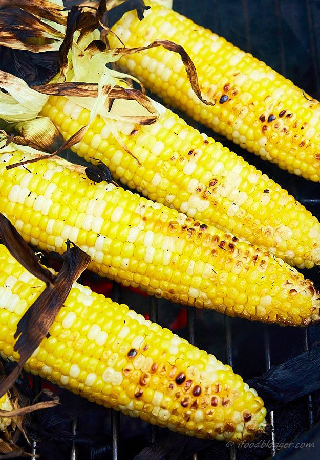 The best grilled corn on the cob comes from the simplest of the ingredients. Mayo, fresh garlic, bacon and salt is all you need. And some cayenne for a little heat. After grilling in husks, finish off with husks pulled back for more flavor.