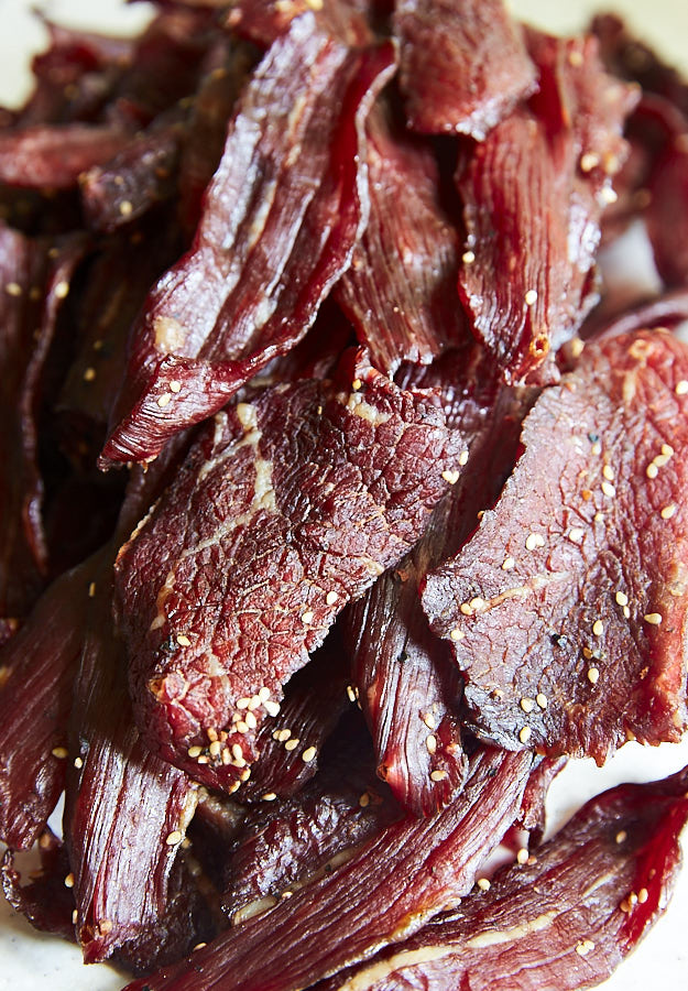 Learn how to make beef jerky in the oven - a simple guide to make traditional, chewy jerky that is better than any store-bought jerky, and safe to eat.