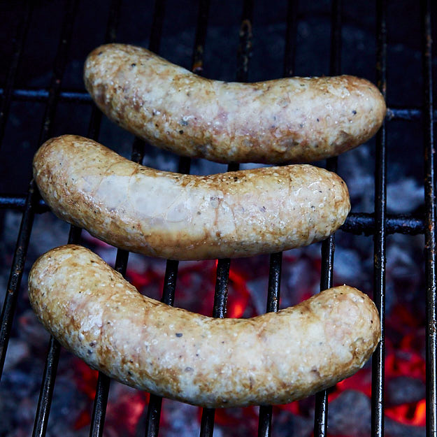 Here is the best way to cook brats to end with juicy, flavorful sausages that snap when you bite into them. Grilled over direct heat, with Mesquite smoke. You may also like Beer Brats using Alton Brown's recipe for that malty beer flavor.