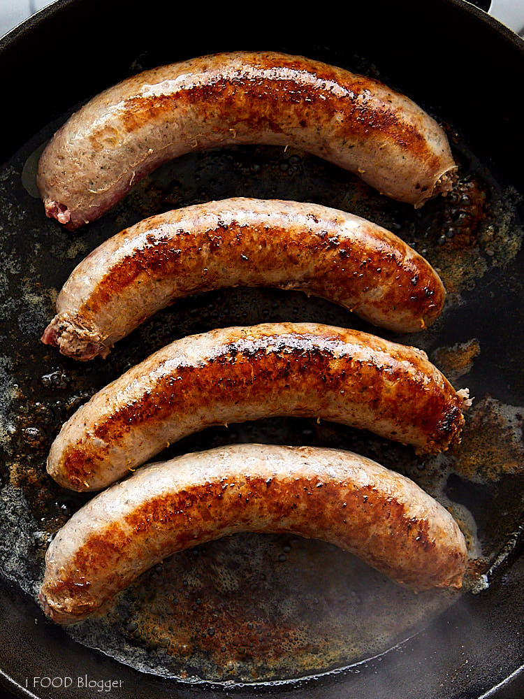 How to Cook Brats on the Stove - Step 2 - Pan Sear Brats | ifoodblogger.com