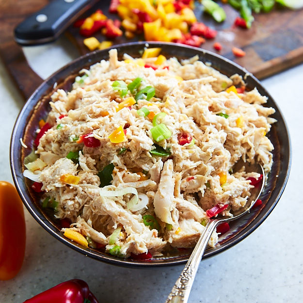 How to make shredded chicken in 15 minutes. This shredded chicken that perfect for sliders and many other dishes. Add scallions, mayo and bell peppers, and make an awesome sandwich.