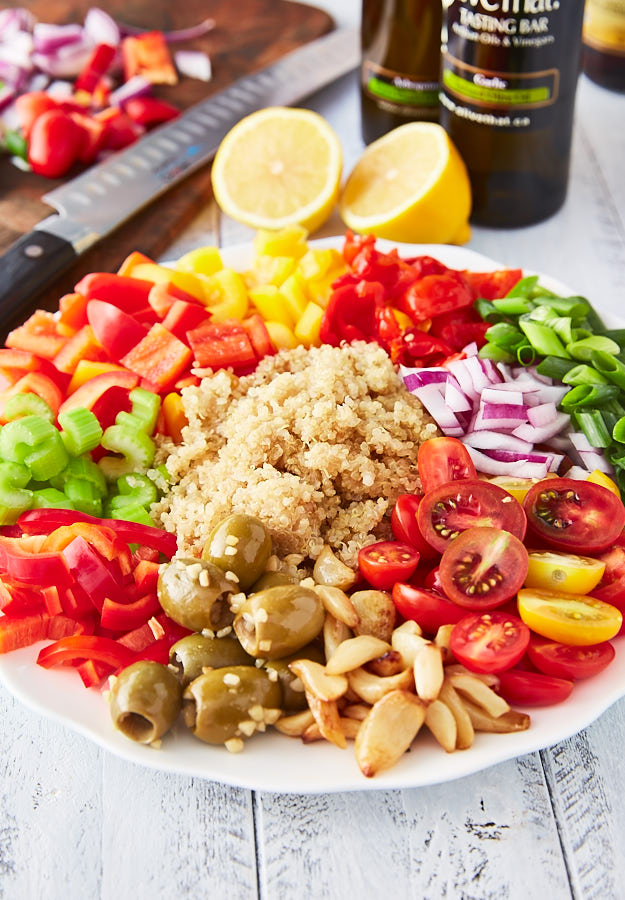 Not just another Mediterranean quinoa salad recipe. This recipe emphasizes a variety of sweet peppers, heirloom tomatoes, roasted garlic, pickled peppers and more. It's tasty, healthy and a pleasure to look at. A must try!