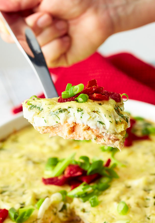 This super easy oven-baked salmon features hard boiled eggs layered over salmon and baked topped with Gouda cheese. Fabulously delicious!