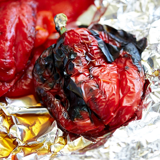 Charred bell pepper on foil.