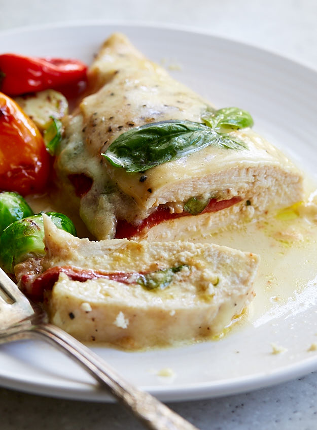 Roasted bell pepper, basil and fresh mozzarella stuffed chicken breast baked in the oven. Fabulously delicious and very easy to prepare.