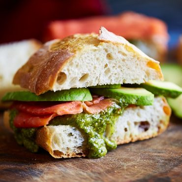 Scandinavian smoked salmon sandwich with avocado and toasted pine nut, basil and dill pesto on a crusty baguette or ciabatta bread. Delish!!!