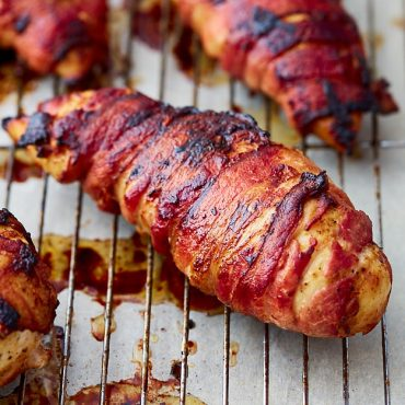 Super crispy bacon-wrapped chicken breast baked in the oven. To get the bacon super crispy use this little trick and you will love the results. Crispy bacon on the outside and tender and juicy chicken on the inside. Pure goodness!