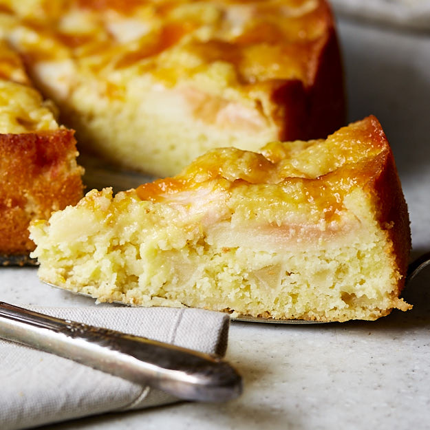 This recipe for a super moist German apple cake is a must try. The addition of almond paste and peach jam make it moister and more flavorful. A little extra effort is required to make it, but it's very well worth it.