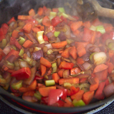 Sauteing vegetables for pork pie with beer and phyllo dough.