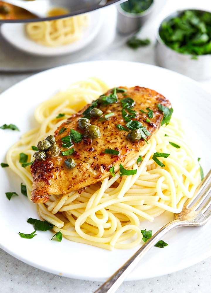 Easy Chicken Piccata - super quick and simple to make with the ingredients you most likely have on hand! Serve with freshly made pasta for best results.