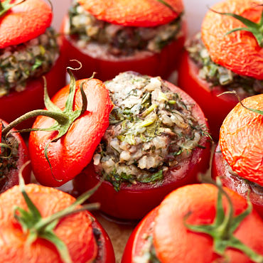 Ridiculously flavorful and delicious stuffed tomatoes with beef and rice, called tomato dolmas. Served with hot tomato sauce that is out-of-this-world good.