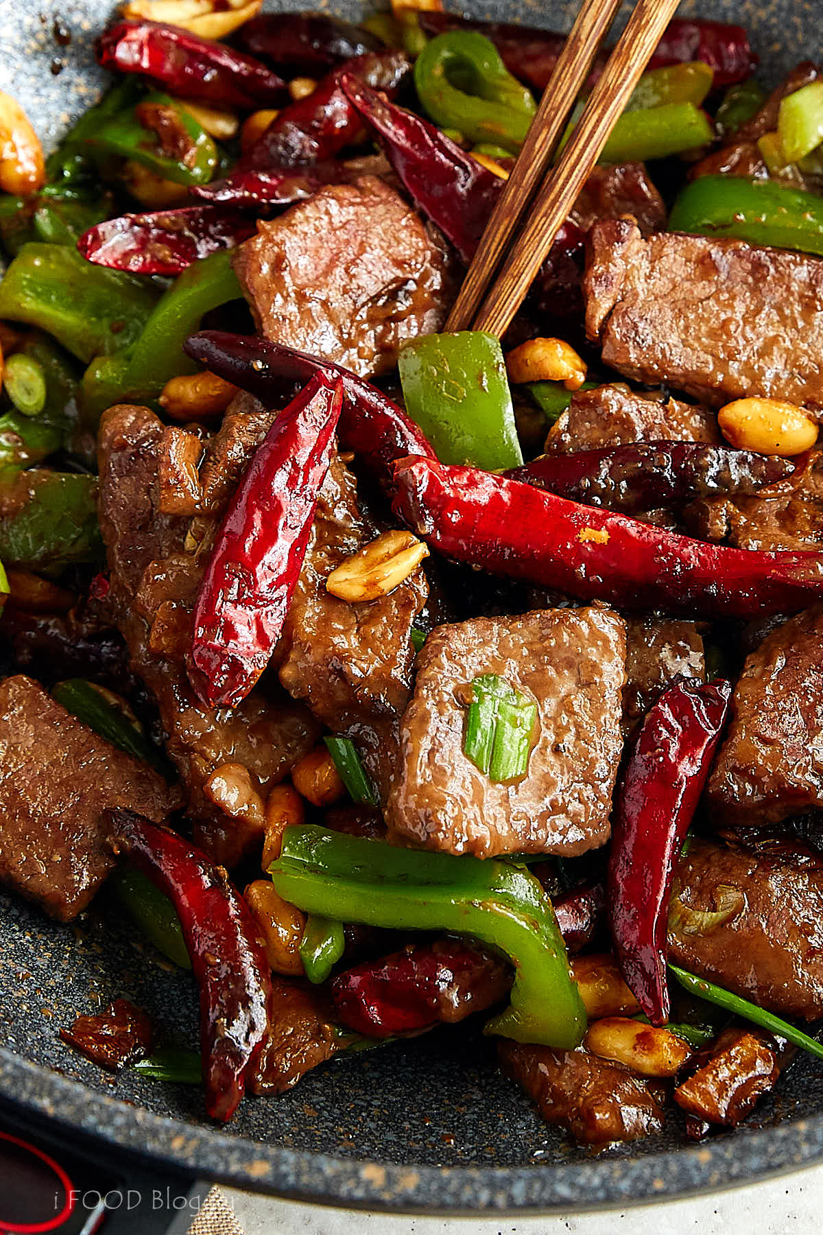Kung Pao Beef, spiced with traditional Szechuan peppers and red chiles, this dish will make you forget about take out for good. The best kung pao beef recipe. | ifoodblogger.com
