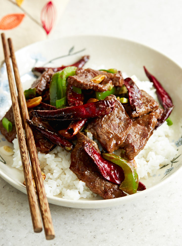 Kung Pao Beef is a Chinese dish that combines sliced steak, a sauce, vegetables and peanuts. Spiced with traditional Szechuan peppers and red chiles, this dish will make you forget about take out for good.