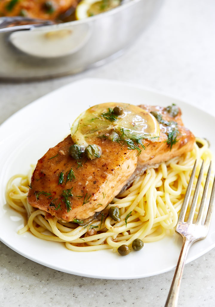 Salmon piccata is a seafood version of the popular chicken piccata, and is very easy and quick to make. Imagine all the same wonderful flavors, only the creamy tender, perfectly cooked salmon covered in velvety smooth, thickened tart and buttery sauce. You can make this gourmet dish at home in less than 20 minutes or so.