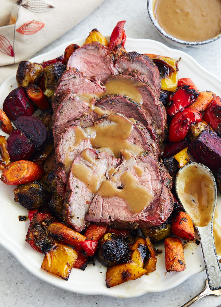 Top Round Roast, cooked low and slow, until perfectly fork-tender. Garlic and herb-crusted, this roast is a delight. Serve with roasted vegetables for a healthy, low-carb, paleo-friendly meal.