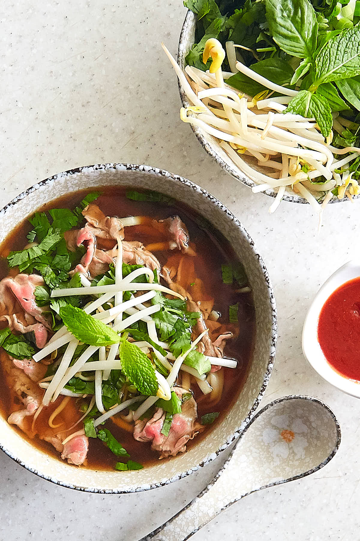 Authentic beef pho (pho bo) that will captivate you with its aroma and the taste that seamlessly combines salty, sweet, and umami all in one. The beef pho recipe comes from a restaurant that is famous for its pho bo. A must try. | ifoodblogger.com