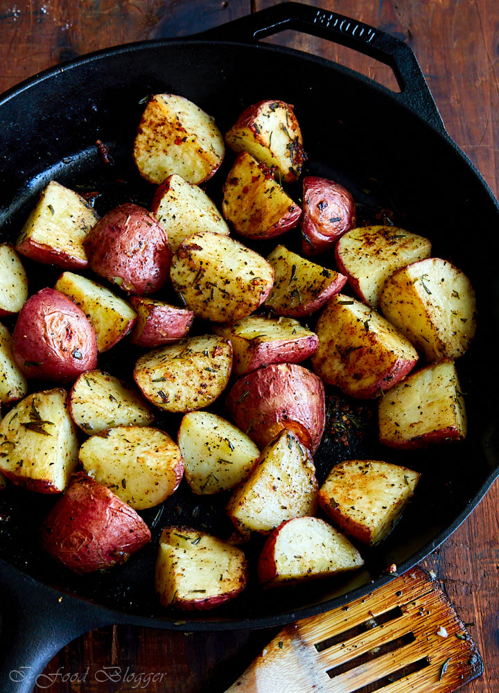 Rosemary garlic roasted red potatoes roasted in a cast iron pan for that amazing browned, crispy exterior and tender, creamy interior.