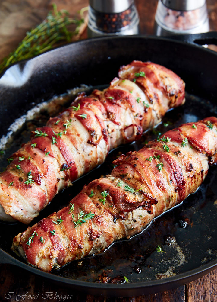 Amazingly flavorful from fresh thyme, garlic and shallots, this pan-seared bacon-wrapped pork tenderloin is tender inside, with a crispy bacon skin.
