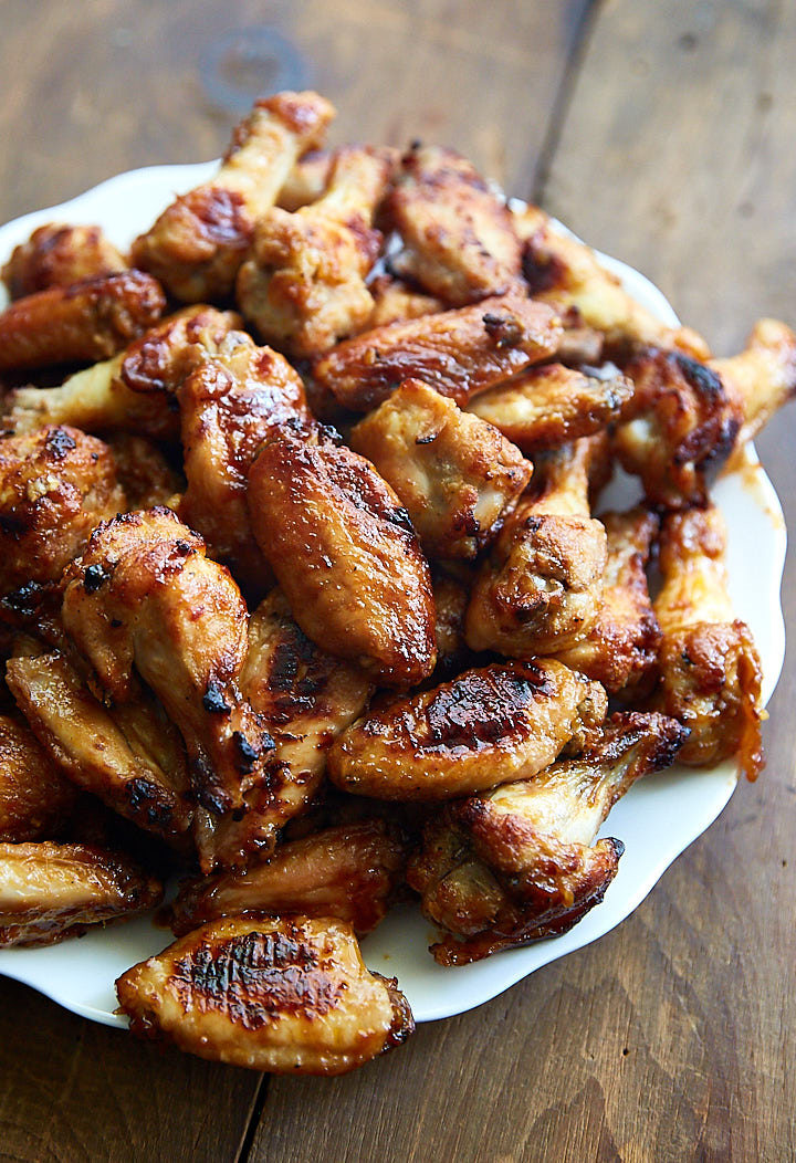 These baked chicken wings taste like grilled. If it weren't for lack of smoky flavor, it would be hard to tell they weren't grilled. Only 35 min to bake!