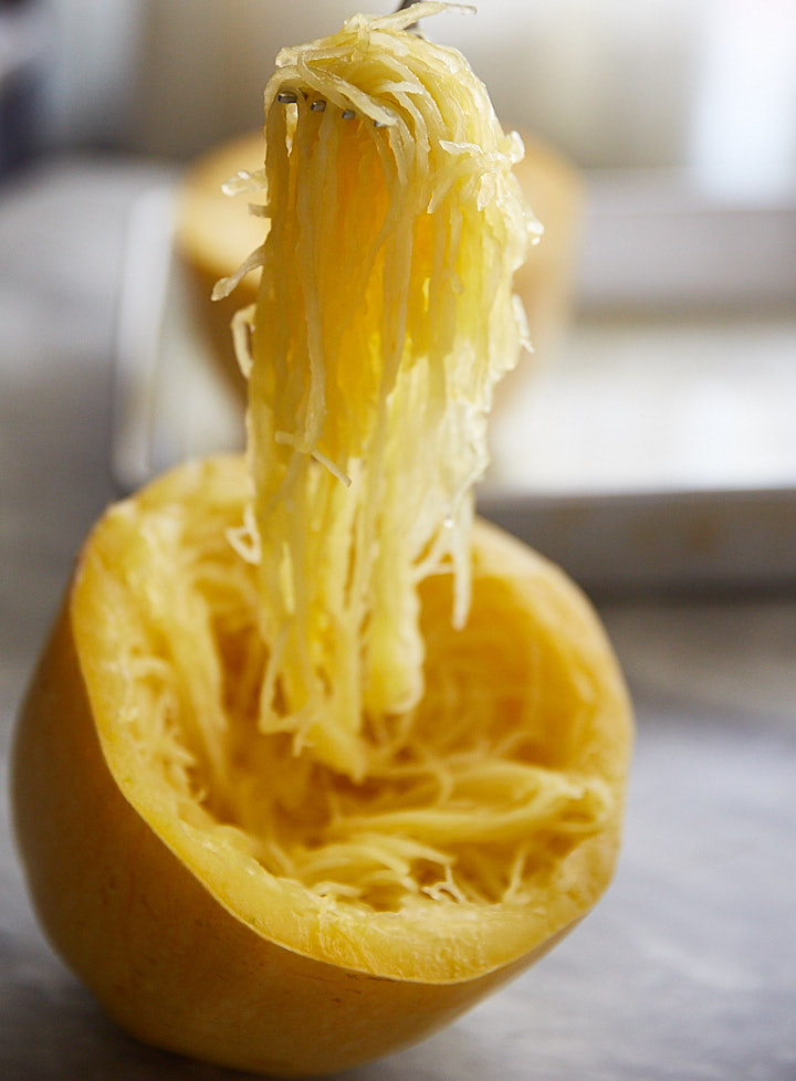 Full of Fall flavors, this spaghetti squash with fresh tomatoes and herbs recipe is amazingly delicious. In fact, it's so good that you won't be asking for pasta any time soon. I think this dish tastes almost like traditional spaghetti.