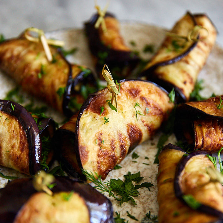 Fried Eggplant with Garlic and Herbs - golden-brown and perfectly tender slices of fried eggplant rolled up with garlic, herbs and sprinkled with wine.