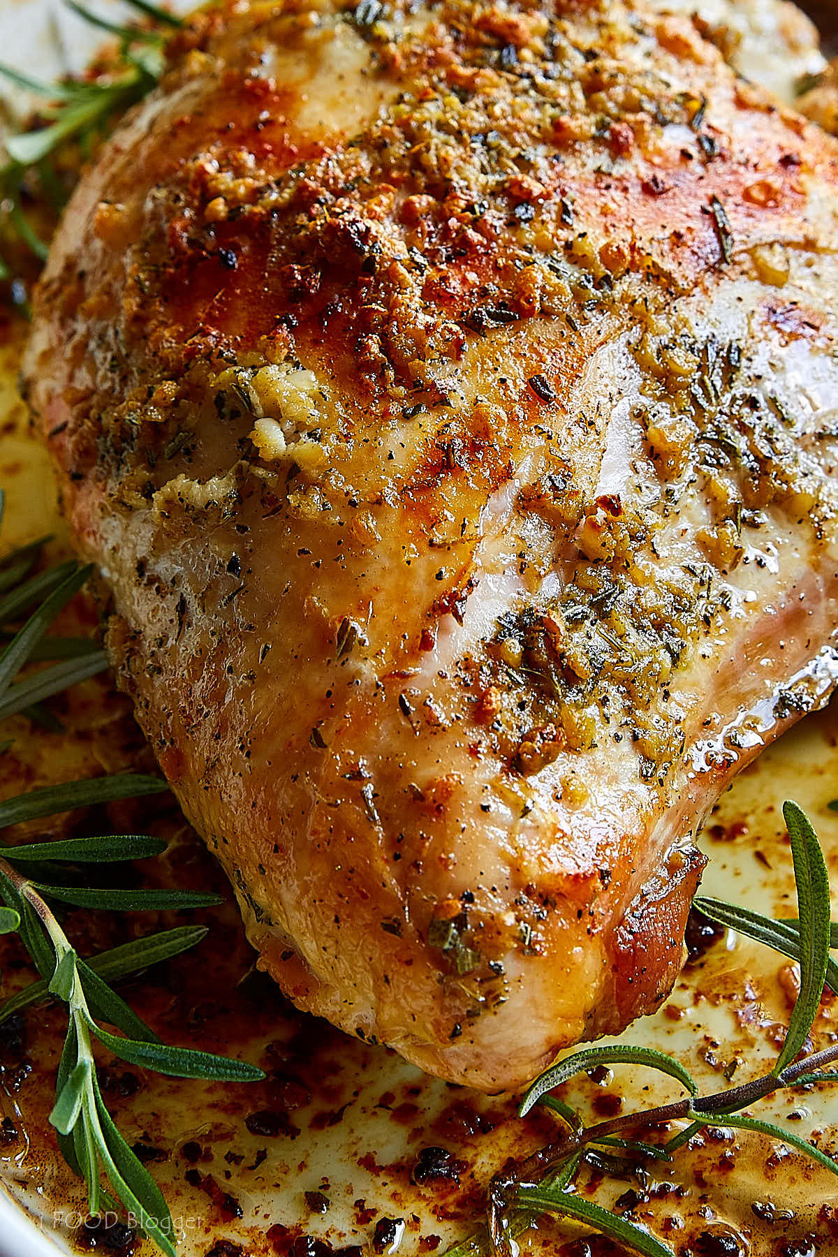This roasted turkey breast, infused with garlic and herb butter is a great alternative to cooking a whole turkey. It cooks much faster and is very tender and incredibly juicy. Perfect for Thanksgiving or Christmas dinner. | ifoodblogger.com