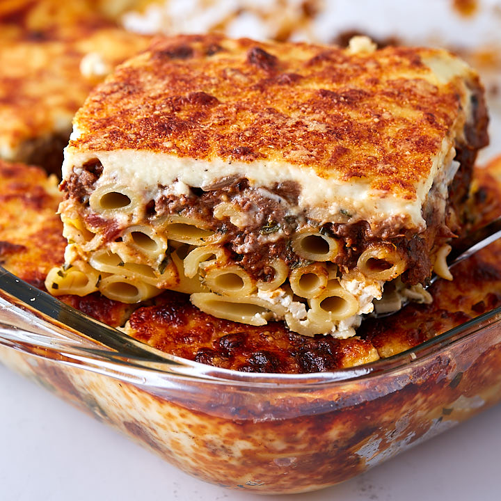 A traditional Greek pastitsio (pasticcio) recipe – layers of ziti pasta, beef sauce, bechamel sauce, sprinkled with Feta and Gruyere cheese!