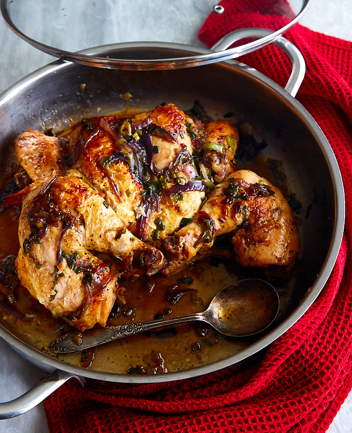 Pan-fried whole chicken, briefly broiled for ultimate flavor and caramelized skin, then pan-fried over low heat for ultimate juiciness and tenderness.
