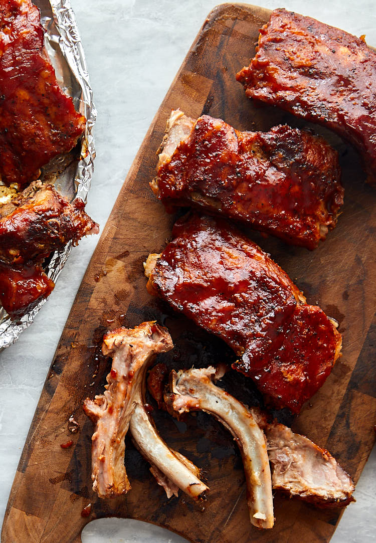 Melt-in-your-mouth-tender Baby Back Ribs Baked in Oven - Show meat falling off the bone