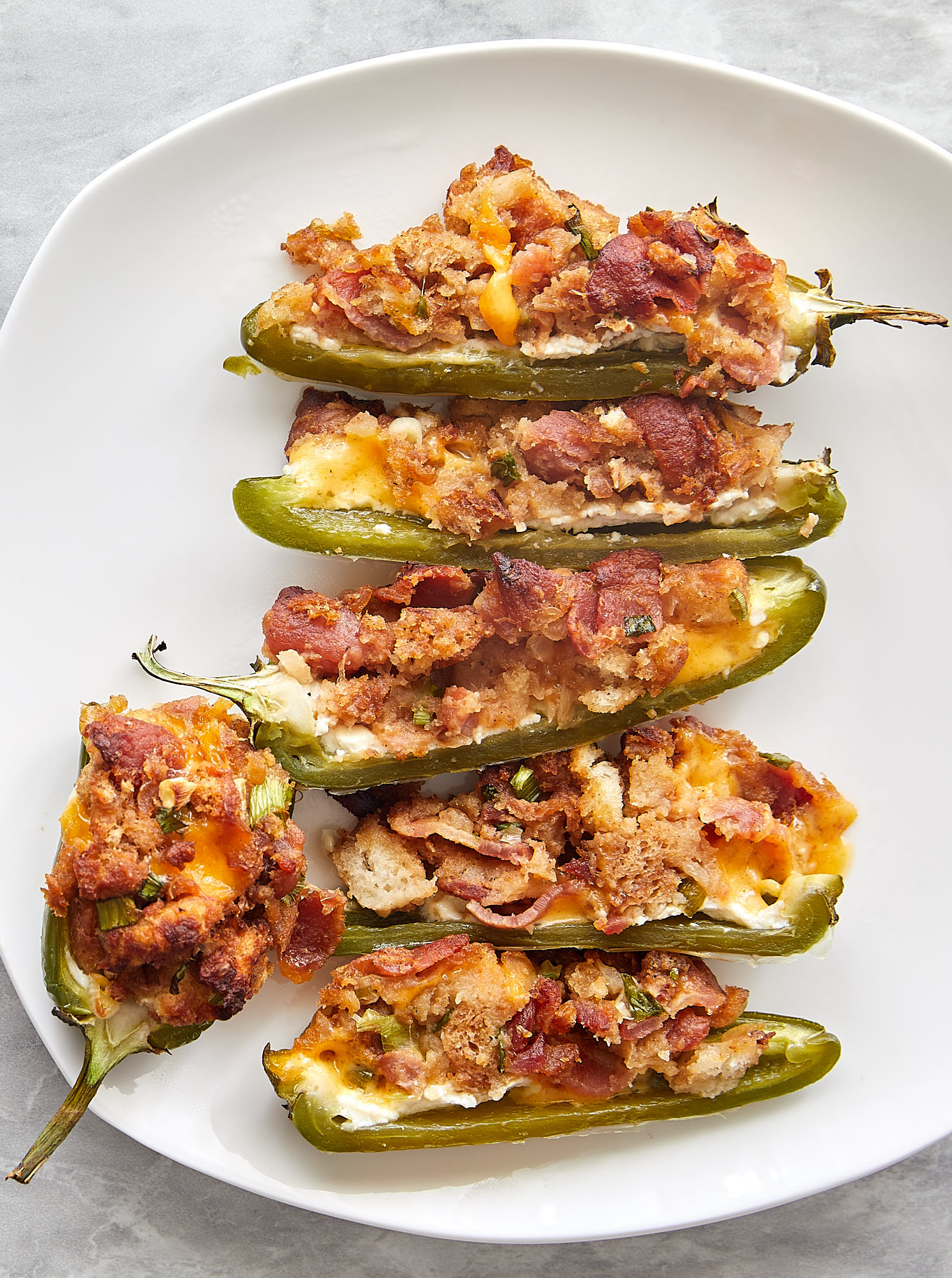 Baked Jalapeno Poppers Supreme - Sliced in Half on a Plate   ifoodblogger.com