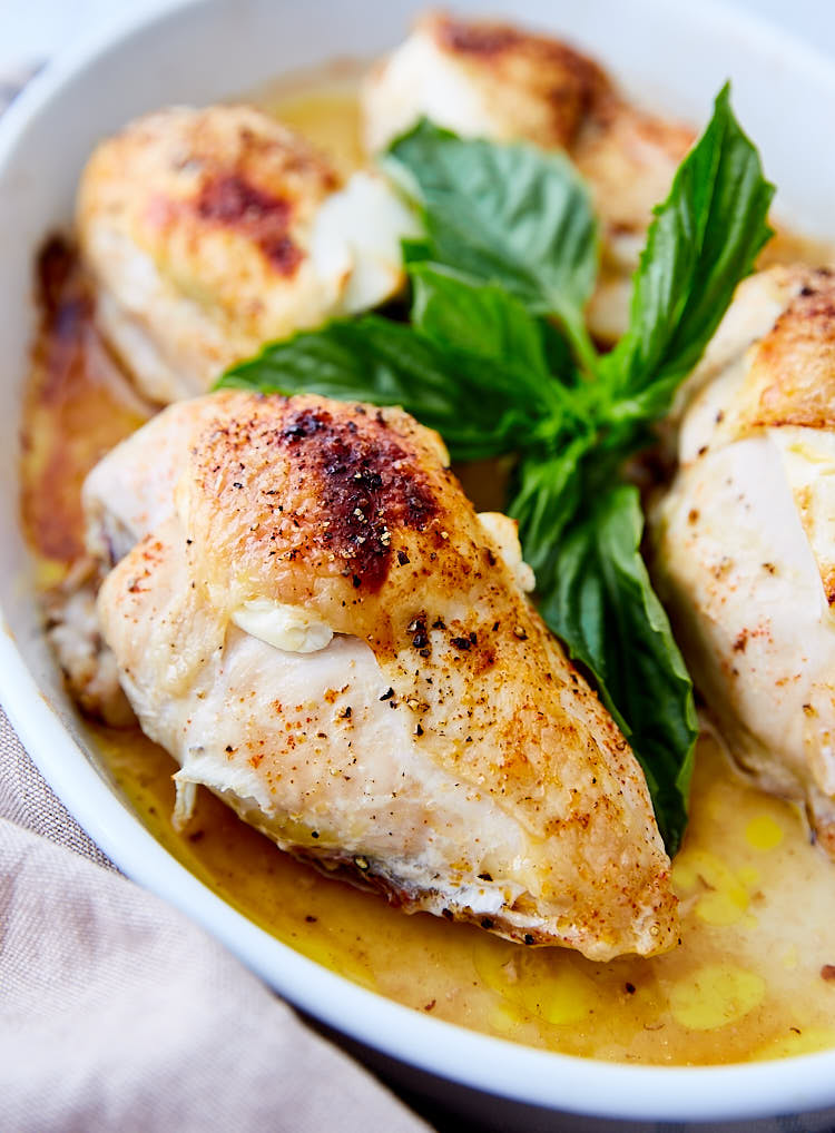 A collection of tried-and-true, best bone-in chicken breast recipes from ifoodblogger.com. Start making them today! | Baked Bone-In Chicken Breast with Goat Cheese and Basil