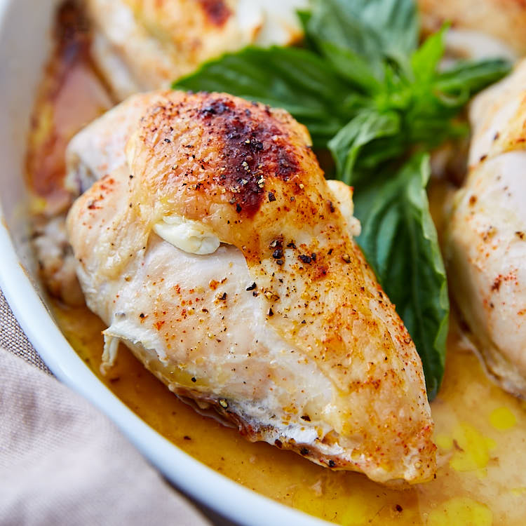 Baked Bone-In Chicken Breast with Goat Cheese and Basil