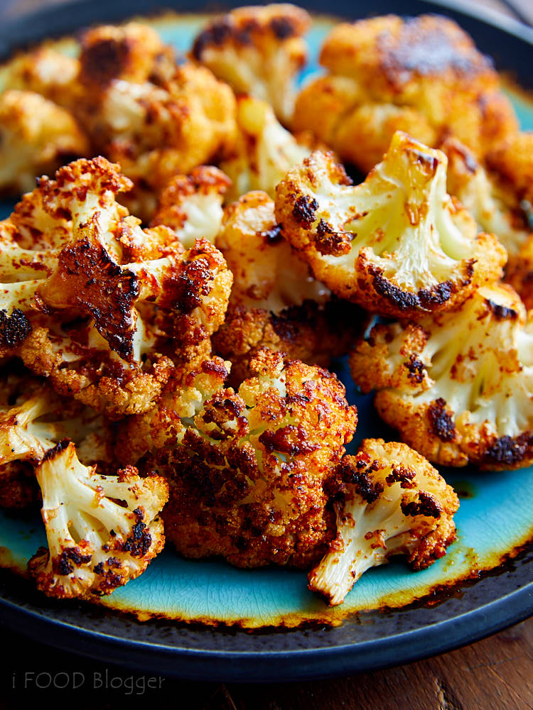 Perfectly roasted cauliflower - crispy on the outside, with caramelized bits of goodness, and tender on the inside. Seasoned with paprika and others spices, this roasted cauliflower can't get any better.
