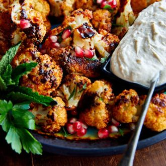 Crispy Roasted Cauliflower with Tahini Sauce and Pomegranate Molasses. You won't find a better tasting cauliflower than this. A must try! | ifoodblogger.com