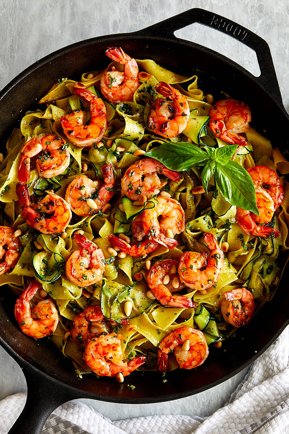 Homemade pesto shrimp pasta made quickly and easily, a great recipe for a busy weekday dinner.   ifoodblogger.com #dinner #dinnerrecipes #easyrecipes #pastarecipes #shrimp #shrimprecipes