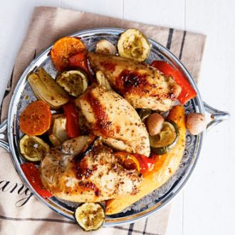 This roasted chicken breast and vegetables dish is an adaptation of Yotam Ottolenghi's oven roasted chicken with clementines and arak. It's 'citrusy' and intensely flavored. In a very good way.