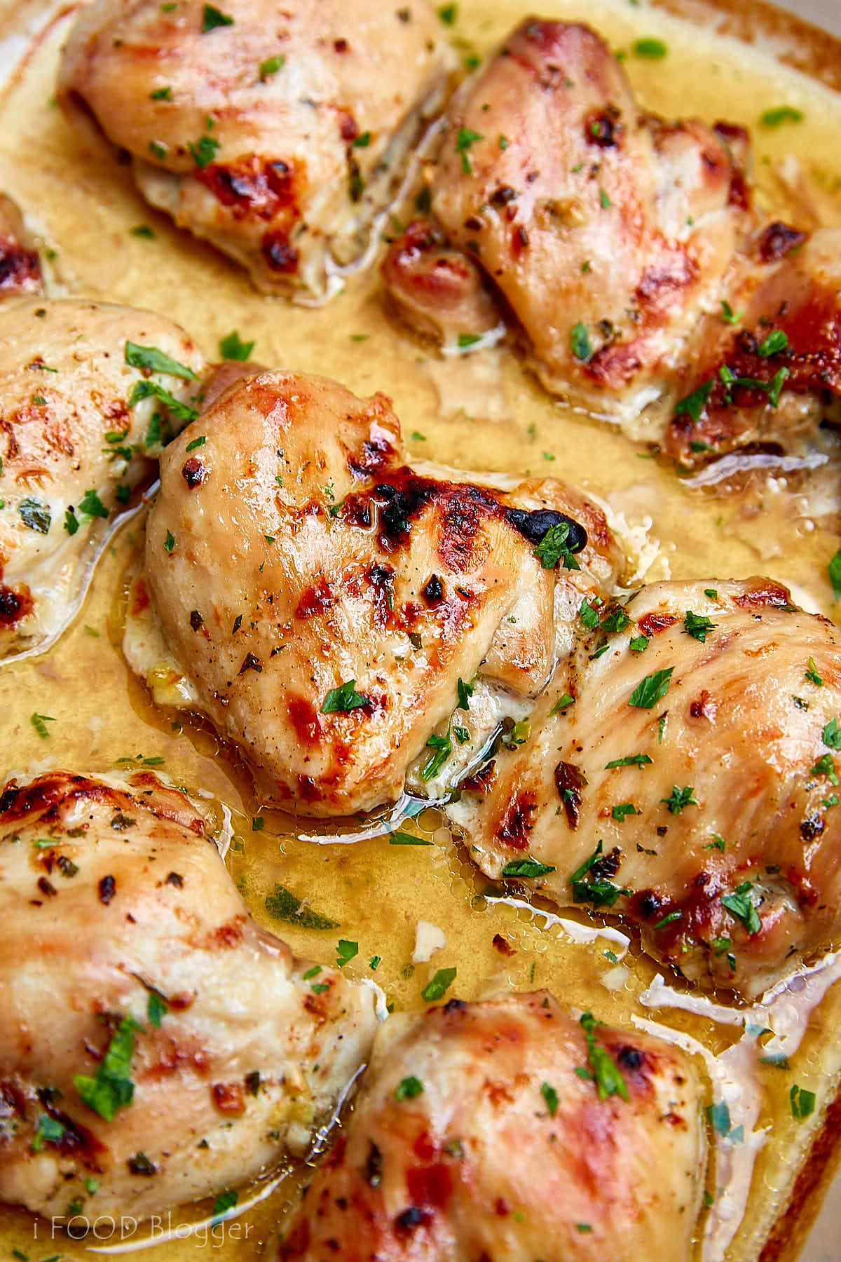 Baked chicken thighs, boneless and skinless, seasoned with maple syrup, apple cider vinegar, garlic, fresh parsley and sesame oil. Tender, slightly sweet and tart, and absolutely delicious. | ifoodblogger.com