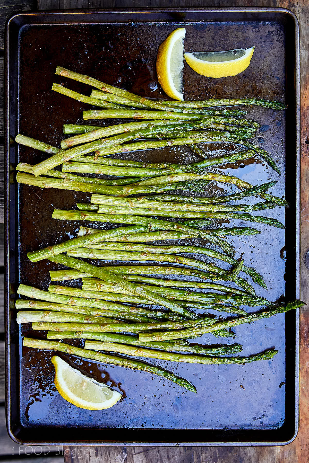 Broiled asparagus, tenderized with a quick parboil, seasoned with lemon juice, salt and pepper, and garnished with Parmigiano Reggiano cheese. | ifoodblogger.com