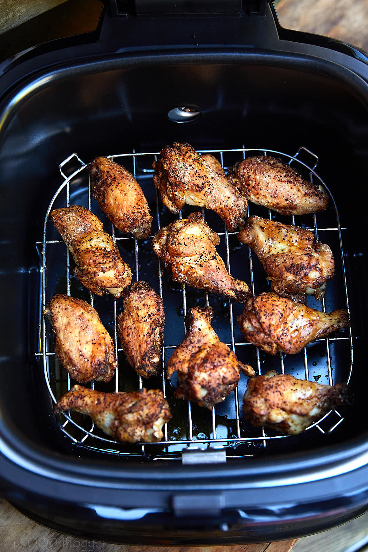 These air fryer chicken wings are extra crispy on the outside and super juicy inside. They are like deep-fried wings, only without a mess and added calories. They taste amazingly good! I guarantee you, these are some of the best chicken wings you can make. These chicken wings are a must try! Oh, and they only take 20 minutes to fry. Great for keto, paleo and low carb diets.| ifoodblogger.com