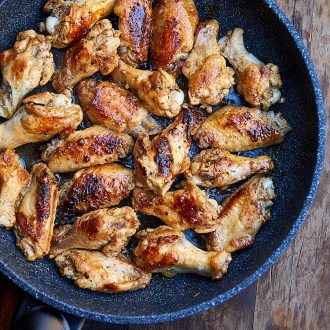 Learn how to fry chicken wings to make them super tender and flavorful. Try this recipe, you will love it. Chicken wings are first pan seared then cooked covered over low heat. All done in 30 minutes. | ifoodblogger.com
