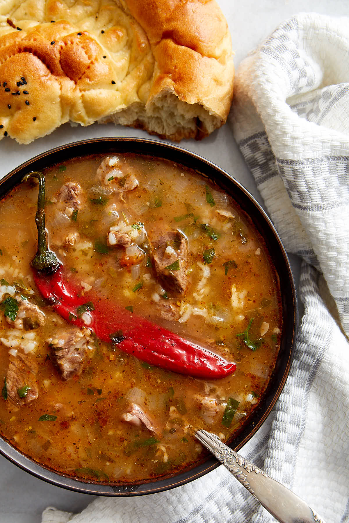 Beef Soup Kharcho - a famous Georgian soup known and loved all over the world. This is a classic version of Kharcho recipe that is absolutely the best. Hearty, beefy and so delicious. A perfectly comforting soup for a cold wintry day. | ifoodblogger.com