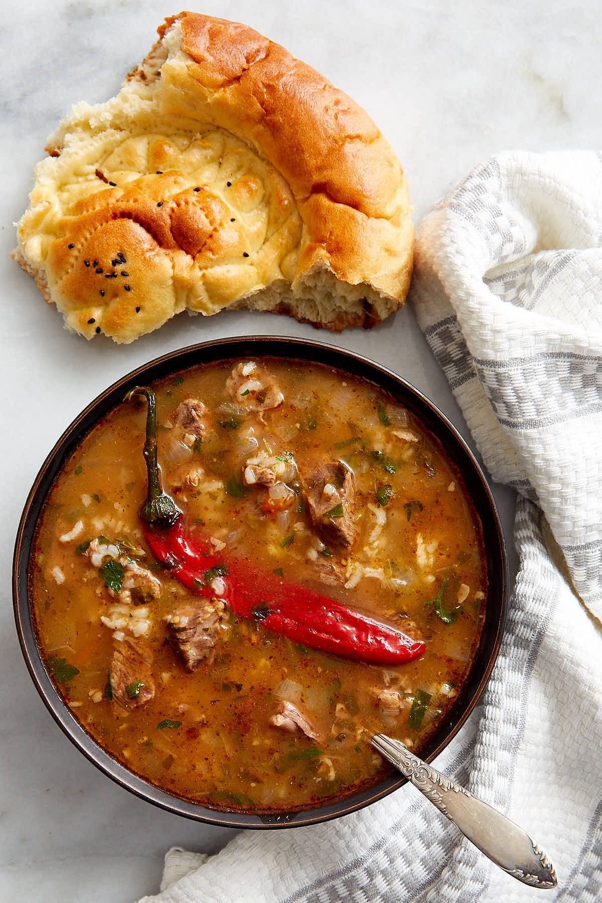Beef Soup Kharcho - a famous Georgian soup known and loved all over the world. This is a classic version that is absolutely the best. Hearty, beefy and so delicious. A perfectly comforting soup for a cold wintry day. | ifoodblogger.com